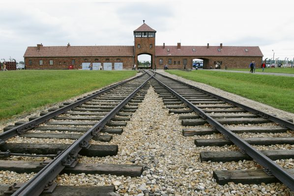 01 Jun 2003, Auschwitz, Poland --- Entrance to the infamous Auschwitz-Birkenau death camp which operated 4 gas chambers where 6,000 people were put to death each day by the Nazi regime. Nazi officers tried to burn documents and dismantle buildings and eradicate traces of gas chambers and crematoria. In 1947, the Polish Parliament set up the Auschwitz-Birkenau State Museum in Auschwitz I and Auschwitz II-Birkenau. --- Image by © Philippe Giraud/Good Look/Corbis